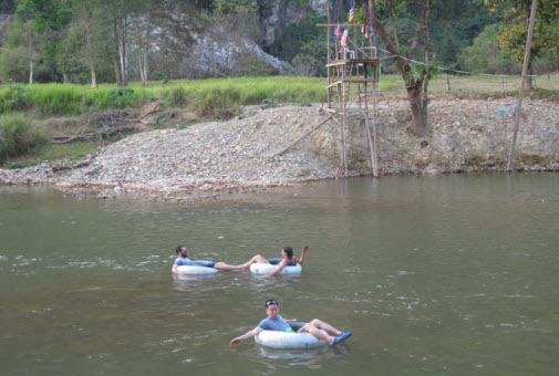 Relaxing tubing on the river Vang Vieng